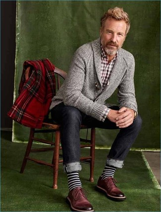 How to wear: burgundy leather derby shoes, navy jeans, burgundy gingham long sleeve shirt, grey shawl cardigan