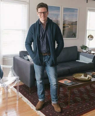 How to Wear Tan Suede Chelsea Boots For Men: Try pairing a navy shawl cardigan with light blue jeans to assemble a truly dapper and modern-looking casual ensemble. You could follow a more classic route in the shoe department by rocking a pair of tan suede chelsea boots.