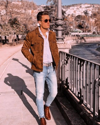 How to wear: tobacco leather chelsea boots, light blue jeans, light blue vertical striped long sleeve shirt, tobacco suede shirt jacket