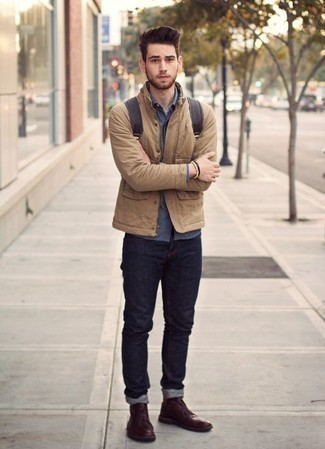 How to Wear a Navy Chambray Long Sleeve Shirt For Men: A navy chambray long sleeve shirt and navy jeans are a good combo to keep in your daily styling arsenal. Finish off with a pair of burgundy leather desert boots et voila, your ensemble is complete.