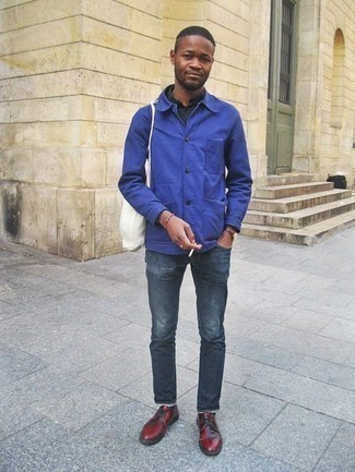 How to Wear a White Canvas Tote Bag For Men: Wear a blue shirt jacket with a white canvas tote bag for a relaxed twist on day-to-day style. On the shoe front, go for something on the more elegant end of the spectrum by sporting a pair of burgundy leather derby shoes.