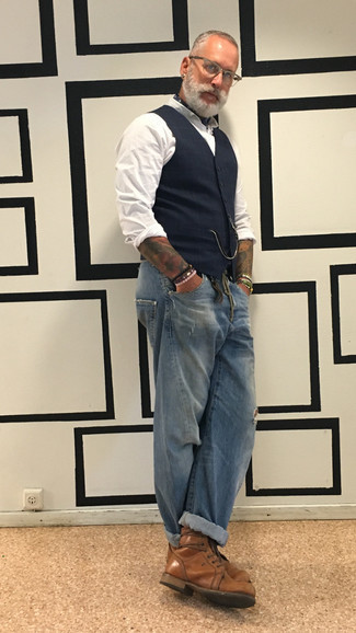 Men's Looks & Outfits: What To Wear In 2020: Show off your fashion-forward side in a navy plaid waistcoat and blue ripped jeans. Break up this getup with a more polished kind of footwear, such as these brown leather casual boots.