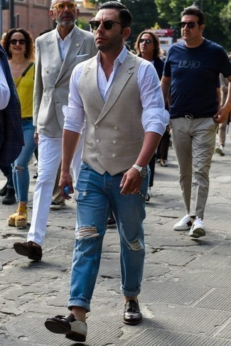 How to Wear a Beige Waistcoat: Teaming a beige waistcoat with blue ripped jeans is a nice choice for an effortlessly neat menswear style. Feeling brave? Change up your ensemble by finishing with a pair of dark brown leather tassel loafers.
