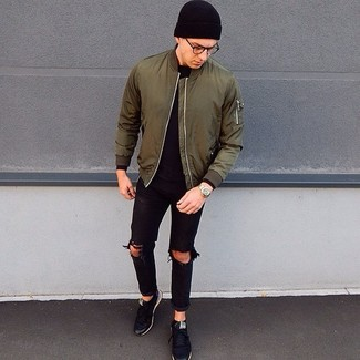 How to wear: black low top sneakers, black ripped jeans, black long sleeve t-shirt, olive bomber jacket