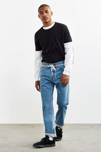 How to Wear Blue Jeans For Men: Rock a white and black print long sleeve t-shirt with blue jeans to create a really dapper and modern-looking casual outfit. All you need now is a pair of black suede low top sneakers to complete your look.