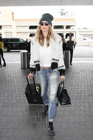 How to wear: black leather low top sneakers, blue ripped jeans, white long sleeve t-shirt, white and black fur jacket