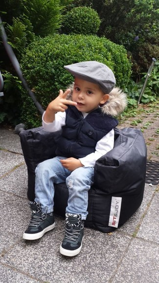 How to Wear a White Long Sleeve T-Shirt For Boys: A white long sleeve t-shirt and light blue jeans are a nice outfit for your little one to wear when you go on walks. As for footwear your little one will love black leather sneakers for this getup.