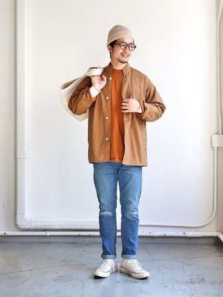 Men's Looks & Outfits: What To Wear In 2020: Pair a tan long sleeve shirt with blue ripped jeans for equally stylish and easy-to-style outfit. Let your styling savvy truly shine by completing your look with a pair of white canvas high top sneakers.