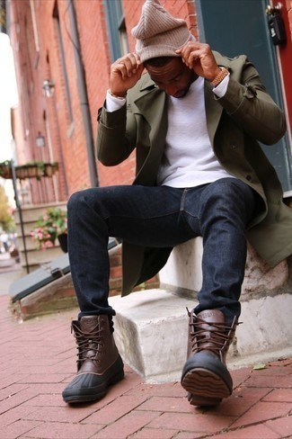 Men's Looks & Outfits: What To Wear In 2020: For a look that's semi-casual and GQ-worthy, marry an olive trenchcoat with navy jeans. Put a fresh spin on your getup by finishing off with brown leather snow boots.