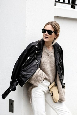 How to Wear White Jeans In Chill Weather For Women: You'll be surprised at how extremely easy it is to get dressed like this. Just a black leather biker jacket and white jeans.