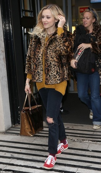 How to wear: red low top sneakers, black ripped jeans, mustard oversized sweater, brown leopard fur jacket