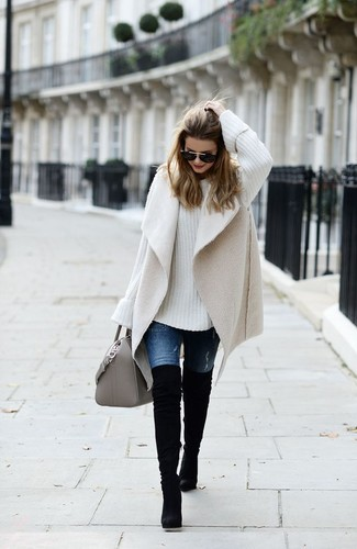 How to wear: black suede over the knee boots, blue jeans, white knit oversized sweater, beige shearling vest
