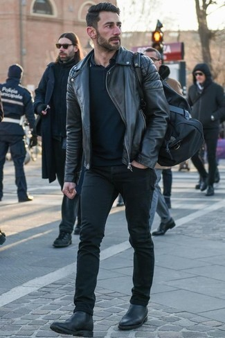 How to Wear Black Jeans For Men: This combo of a black leather biker jacket and black jeans is undeniable proof that a pared down casual outfit doesn't have to be boring. Play up the formality of your getup a bit with a pair of black leather chelsea boots.