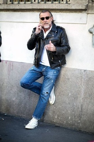 Fashion for Men Over 50: What To Wear: Pair a black leather biker jacket with blue ripped jeans for relaxed dressing with a contemporary spin. A pair of white canvas high top sneakers looks right at home paired with this ensemble. This combo proves 50-year-old gentlemen can still very well draw compliments.