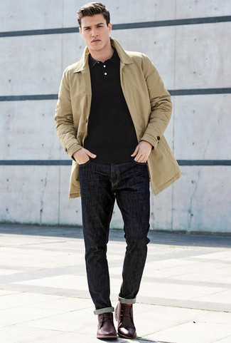How to wear: burgundy leather desert boots, navy jeans, black polo, tan trenchcoat