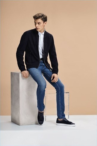 How to Wear Blue Ripped Jeans For Men: A navy suede bomber jacket and blue ripped jeans are great menswear essentials to have in your day-to-day off-duty repertoire. Black suede low top sneakers will breathe an extra touch of style into an otherwise mostly dressed-down outfit.