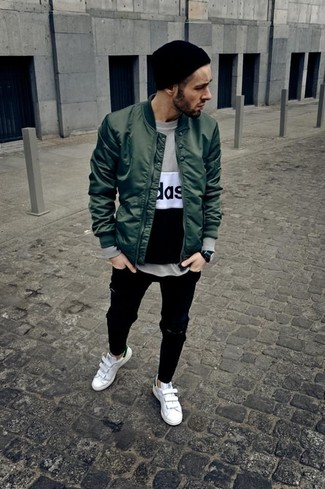 Men's Looks & Outfits: What To Wear In a Relaxed Way: Wear a dark green bomber jacket with black ripped jeans for a look that's both laid-back and sharp. Go ahead and add white leather low top sneakers to the equation for an extra touch of refinement.