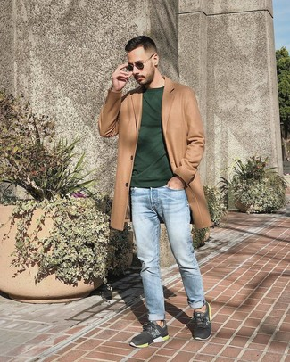 How to wear: charcoal athletic shoes, light blue jeans, dark green sweatshirt, camel overcoat