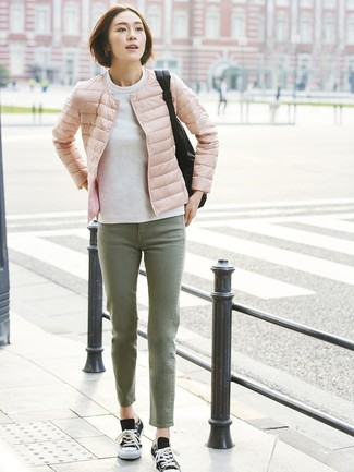 How to wear: black and white canvas low top sneakers, olive jeans, white sweatshirt, pink puffer jacket
