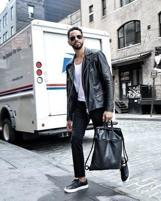 How to Wear a Black Leather Backpack For Men: This combination of a black leather biker jacket and a black leather backpack delivers comfort and utility and helps keep it clean yet modern. Black leather low top sneakers will give a touch of refinement to an otherwise everyday ensemble.