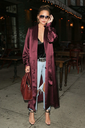How to Wear Clear Rubber Heeled Sandals: For comfort without the need to sacrifice on style, we turn to this combination of a burgundy silk duster coat and light blue ripped jeans. Give a glamorous twist to an otherwise mostly dressed-down getup by rocking clear rubber heeled sandals.