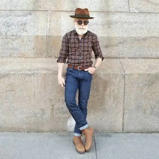 Men's Looks & Outfits: What To Wear In 2020: A brown plaid long sleeve shirt and navy jeans are must-have menswear items to have in the casual part of your wardrobe. Complement this outfit with tan leather casual boots for a bit of polish.