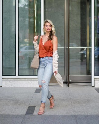 How to wear: beige suede heeled sandals, light blue ripped jeans, orange silk tank, beige knit open cardigan