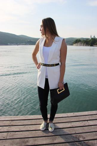 How to wear: gold leather slip-on sneakers, black jeans, white tank, white sleeveless blazer