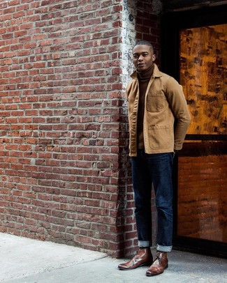 How to wear: brown leather desert boots, navy jeans, brown turtleneck, tan barn jacket