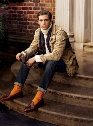 How to wear: brown leather tassel loafers, navy jeans, beige turtleneck, tan barn jacket