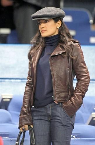 How to wear: black leather tote bag, navy jeans, navy turtleneck, brown leather biker jacket