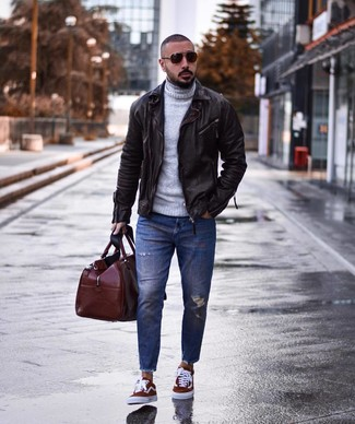 How to wear: burgundy canvas low top sneakers, blue ripped jeans, grey wool turtleneck, dark brown leather biker jacket