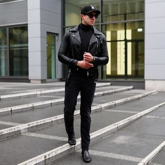 How to wear: black leather chelsea boots, black jeans, black turtleneck, black leather biker jacket