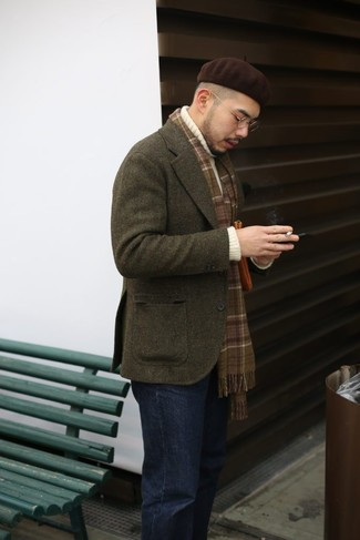 How to wear: dark brown beanie, black jeans, white knit turtleneck, olive wool blazer