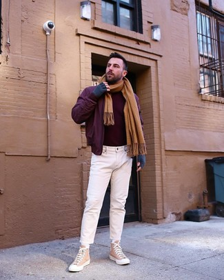 How to wear: tan canvas high top sneakers, white jeans, burgundy turtleneck, burgundy bomber jacket