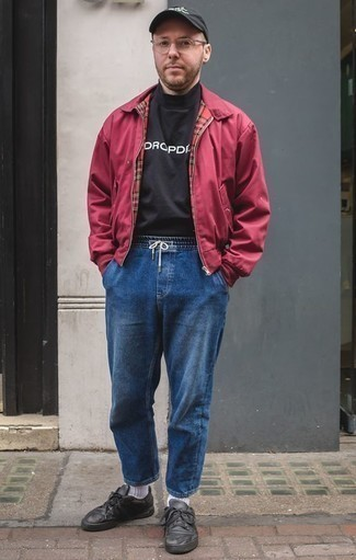 How to Wear a Burgundy Bomber Jacket For Men: A burgundy bomber jacket and blue jeans are a combination that every modern gent should have in his casual arsenal. Complement your ensemble with a pair of black leather low top sneakers and the whole outfit will come together.