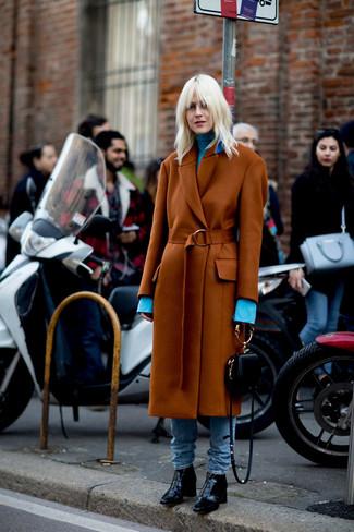 How to wear: black leather ankle boots, light blue jeans, light blue turtleneck, tobacco coat