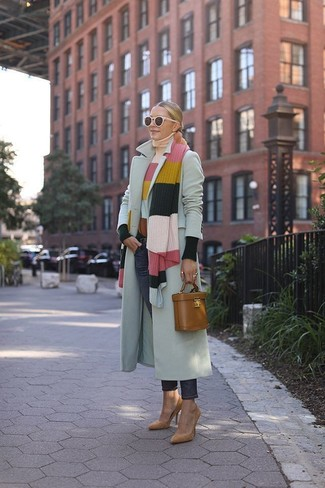 How to wear: tan suede pumps, navy jeans, multi colored horizontal striped turtleneck, grey coat