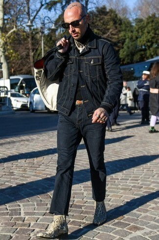 How to Wear Beige Snake Leather Chelsea Boots In Spring For Men: This combination of a navy denim jacket and navy jeans looks pulled together and makes any man look infinitely cooler. Channel your inner Ryan Gosling and introduce a pair of beige snake leather chelsea boots to the equation. With spring coming, it's time to make space for simple and stylish combos, just like this one.
