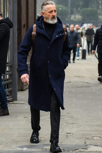 How to Wear a Navy Turtleneck For Men: If you love classic combinations, then you'll like this pairing of a navy turtleneck and black jeans. For something more on the sophisticated side to complement this ensemble, complete your getup with a pair of black leather derby shoes.