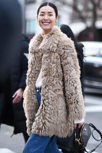 How to wear: black leather crossbody bag, blue jeans, white turtleneck, beige fur coat