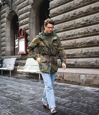 How to wear: black leather tassel loafers, light blue jeans, olive knit turtleneck, olive camouflage military jacket