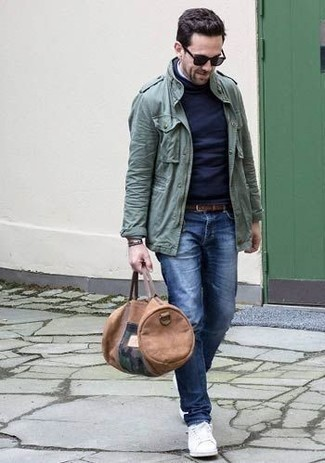 How to Wear a Dark Green Military Jacket For Men: Extremely stylish and practical, this casual combo of a dark green military jacket and blue jeans will provide you with endless styling opportunities. Inject a carefree feel into this look by finishing off with a pair of white leather low top sneakers.