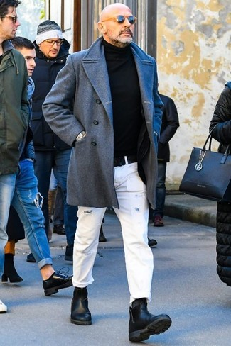 How to wear: black leather chelsea boots, white ripped jeans, black turtleneck, grey overcoat