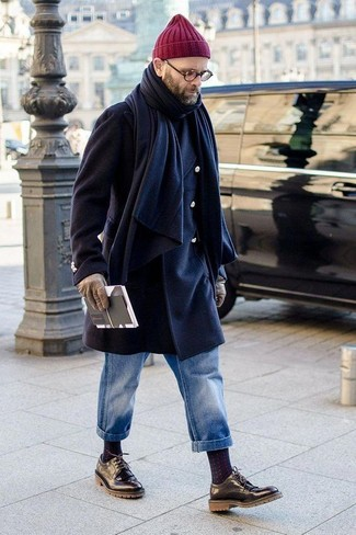 How to wear: black leather derby shoes, blue jeans, black turtleneck, navy overcoat