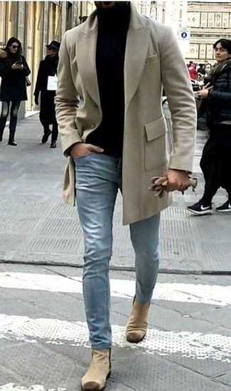 How to wear: beige suede chelsea boots, light blue jeans, black turtleneck, beige overcoat