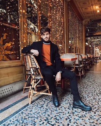 How to wear: black leather chelsea boots, black jeans, orange turtleneck, black overcoat
