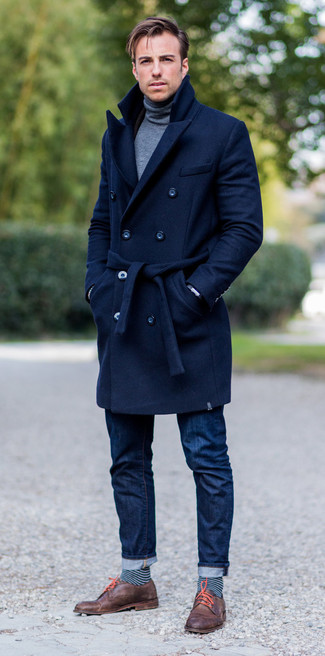 How to wear: brown leather derby shoes, navy jeans, grey turtleneck, navy overcoat