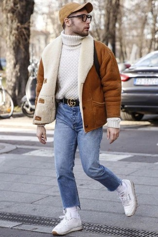 How to Wear Light Blue Jeans For Men: A tobacco shearling jacket and light blue jeans are an easy way to introduce muted dapperness into your daily collection. White leather low top sneakers will add more character to an otherwise dressy getup.