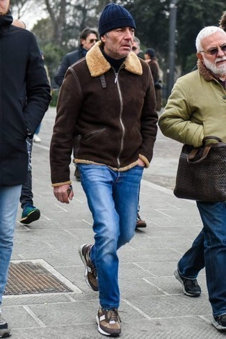 Men's Looks & Outfits: What To Wear In Winter: Extremely dapper, this relaxed combo of a dark brown shearling jacket and blue jeans provides with variety. To give your overall ensemble a more laid-back vibe, why not add brown athletic shoes to the mix? We know it's tough to stay fashionable in extra cold, but this getup is hard proof that it's quite doable.